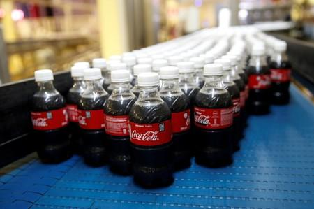 FILE PHOTO: Plastic Coca Cola bottles on the production line at a Coca Cola factory in Nairobi