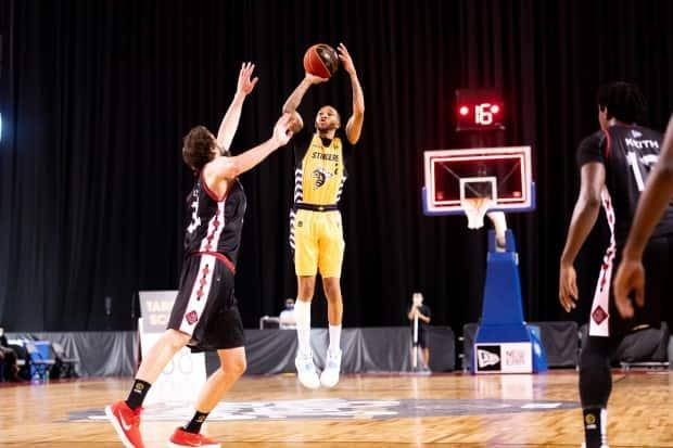 Edmonton Stingers guard Xavier Moon is seen above in a game at the CEBL Summer Series. The 2021 season is officially set to start June 24 after the league received approval from all four provinces for teams to play in their home cities. (CEBL - image credit)