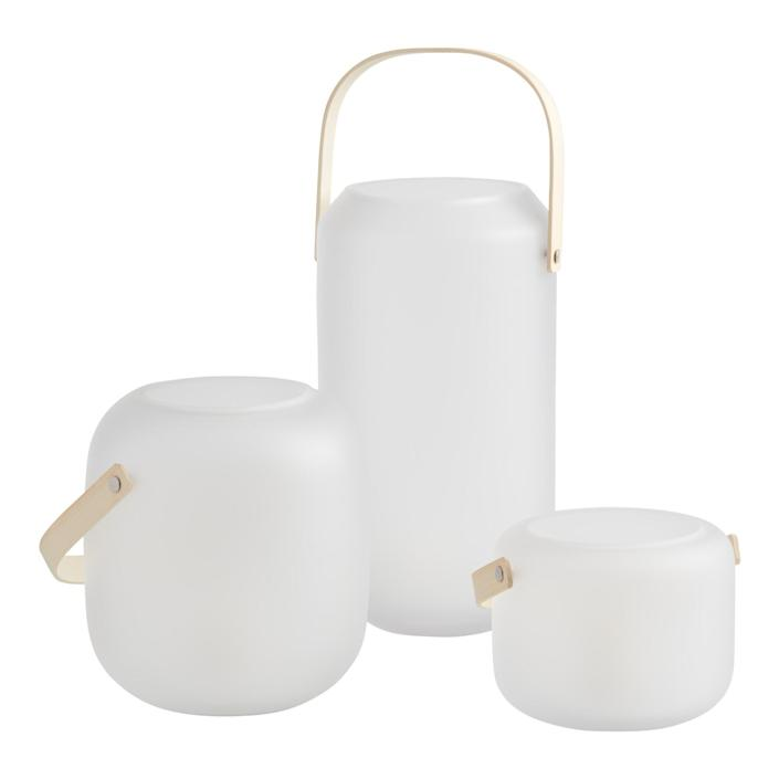 """Give your stoop, fire escape, or backyard some extra ambiance with these sleek lanterns—just add a tealight or a LED candle. Easy for hanging, these lanterns come in a small, medium, or large size. $15, Cost Plus World Market. <a href=""""https://www.worldmarket.com/product/white+frosted+glass+lantern+with+wood+handle.do?sortby=newArrivalsDescend&from=fn"""" rel=""""nofollow noopener"""" target=""""_blank"""" data-ylk=""""slk:Get it now!"""" class=""""link rapid-noclick-resp"""">Get it now!</a>"""