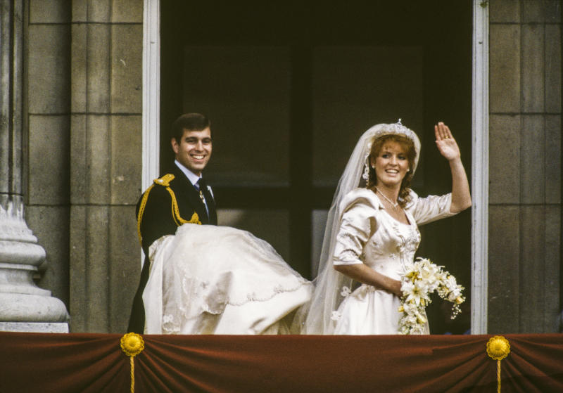 On the balcony of Buckingham Palace, Prince Andrew, Duke of York and Sarah, Duchess of York wave to well-wishers after their wedding, London, England, July 23, 1986.