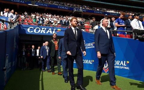 Prince Harry walks onto the pitch before the Challenge Cup Final. - Credit: ADAM HOLT/Action Images via Reuters