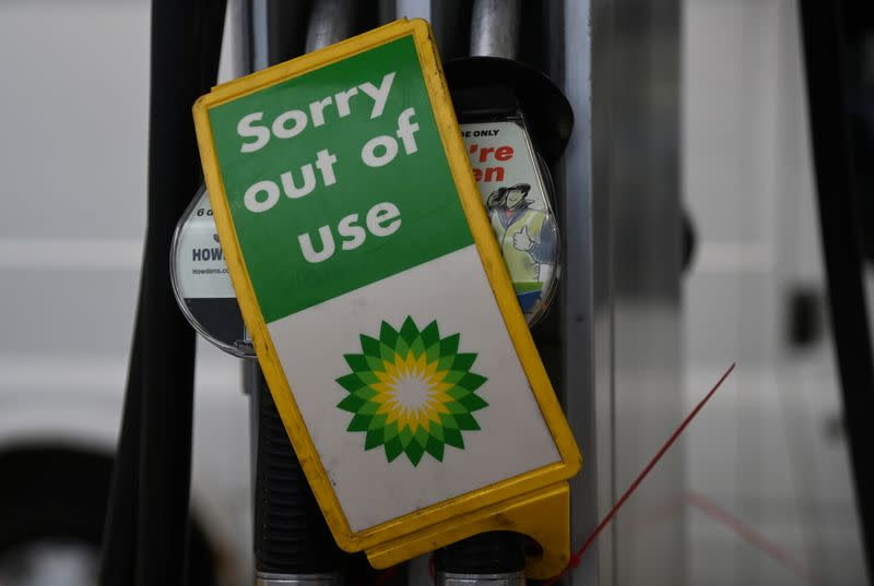 Out of use signs are placed over pumps at a Shell petrol station in London