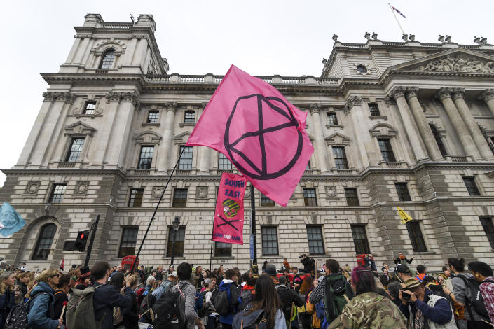 Climate activists gather at Parliament Street in London, Monday, Oct. 7, 2019. (Photo: Alberto Pezzali/AP)