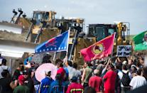 Members of the Standing Rock Sioux Tribe confront bulldozers working on the Dakota Access Pipeline in an effort to make them stop near Cannon Ball, North Dakota on September 03, 2016 (AFP Photo/Robyn Beck)