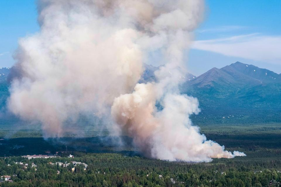 A brush fire burns in South Anchorage, Alaska, Tuesday, July 2, 2019.