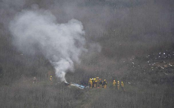 PHOTO: LA county firefighters on the scene of a helicopter crash that killed Kobe Bryant in Calabasas, Calif., Jan. 26, 2020. (Gene Blevins/Reuters)