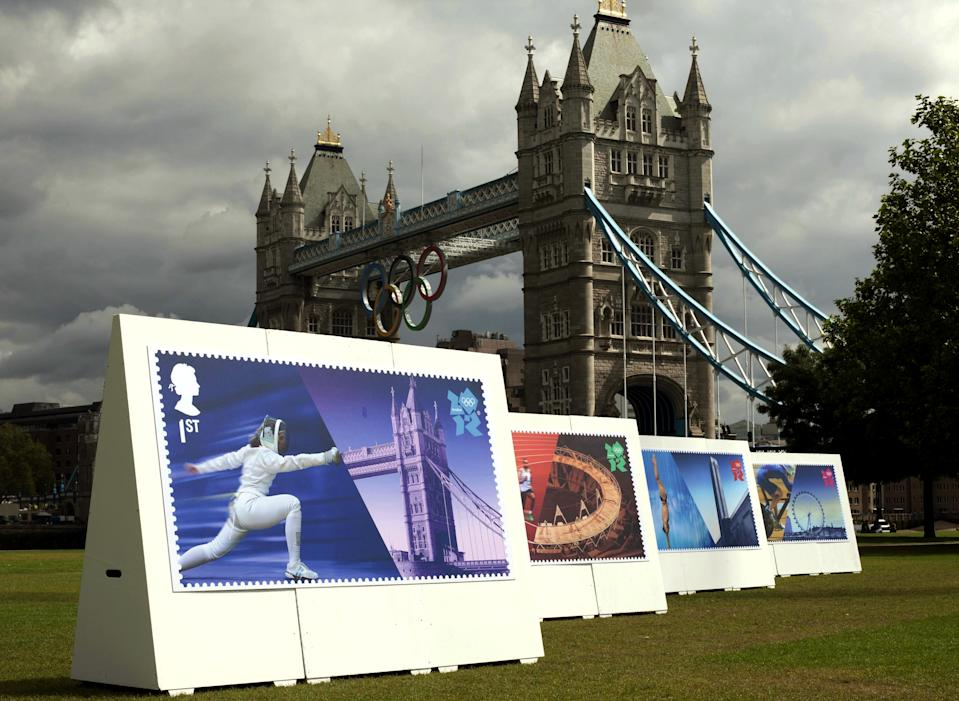 Enlarged images of Royal Mail's Welcome to the London 2012 Olympics stamps are displayed at Potters Fields, London on Monday July 23, 2012. The postal service says it will issue a stamp honoring every member of Team GB who wins a gold medal during the games. It is promising to have them on sale within 24 hours of the athlete's victory. (AP Photo/David Parry, PA)