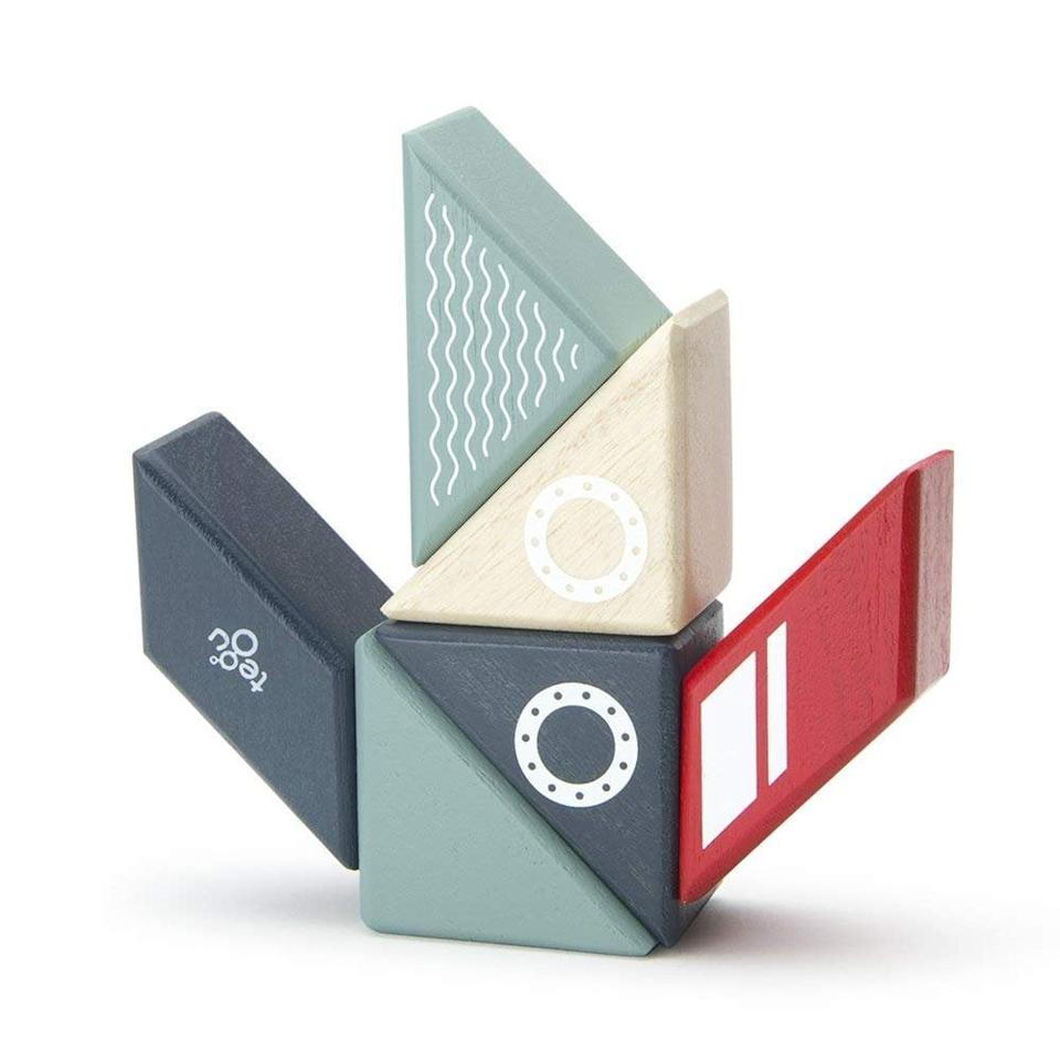 "<p>Kids can create tons of shapes with <a href=""https://www.popsugar.com/buy/Tegu-Travel-Pals-Magnetic-Wooden-Building-Toy-Blocks-523903?p_name=Tegu%20Travel%20Pals%20Magnetic%20Wooden%20Building%20Toy%20Blocks&retailer=amazon.com&pid=523903&price=20&evar1=moms%3Aus&evar9=44092364&evar98=https%3A%2F%2Fwww.popsugar.com%2Ffamily%2Fphoto-gallery%2F44092364%2Fimage%2F44092390%2FTegu-Travel-Pals-Magnetic-Wooden-Building-Toy-Blocks&list1=gift%20guide&prop13=mobile&pdata=1"" rel=""nofollow"" data-shoppable-link=""1"" target=""_blank"" class=""ga-track"" data-ga-category=""Related"" data-ga-label=""https://www.amazon.com/dp/B0749T89WN"" data-ga-action=""In-Line Links"">Tegu Travel Pals Magnetic Wooden Building Toy Blocks</a> ($20).</p>"