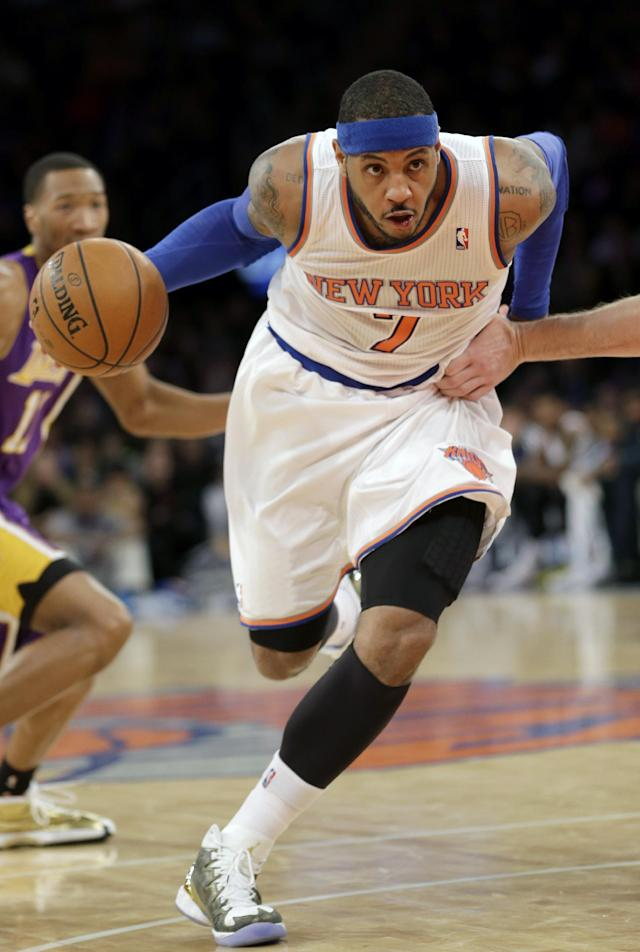 New York Knicks' Carmelo Anthony charges the basket during the second half of an NBA basketball game against the Los Angeles Lakers at Madison Square Garden, Sunday, Jan. 26, 2014, in New York. The Knicks won 110-103. (AP Photo/Seth Wenig)