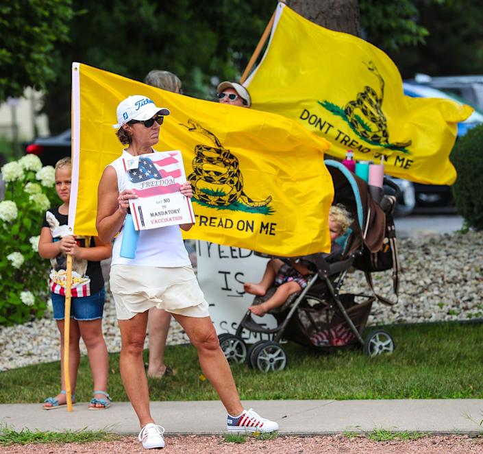 People protest a requirement for all hospital workers to get a COVID-19 vaccination at St. Agnes Hospital in Fond du Lac, Wis., on Aug. 11.