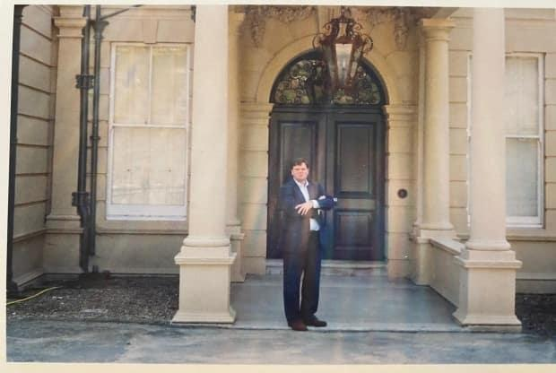 Kevin Fram at the entrance to Cherkley Court, the former home of Lord Beaverbrook.