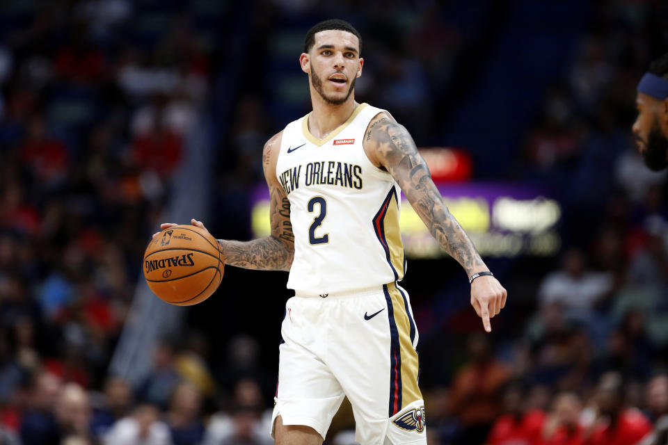 New Orleans Pelicans guard Lonzo Ball (2) in the first half of a preseason NBA basketball game against the Utah Jazz in New Orleans, Friday, Oct. 11, 2019. (AP Photo/Tyler Kaufman)