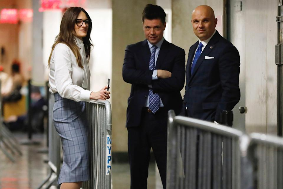 Harvey Weinstein's defense team, Donna Rotunno, Damon Cheronis and Arthur Aidala, huddle in the hallway during jury deliberations in Weinstein's sex-crimes trial in New York on Feb. 21, 2020.