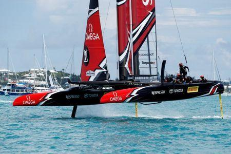 FILE PHOTO - Sailing - America's Cup finals - Peter Burling, Emirates Team New Zealand Helmsman takes his team and boat to the finish line to defeat Oracle Team USA in race nine to win the America's Cup. REUTERS/Mike Segar/File Photo