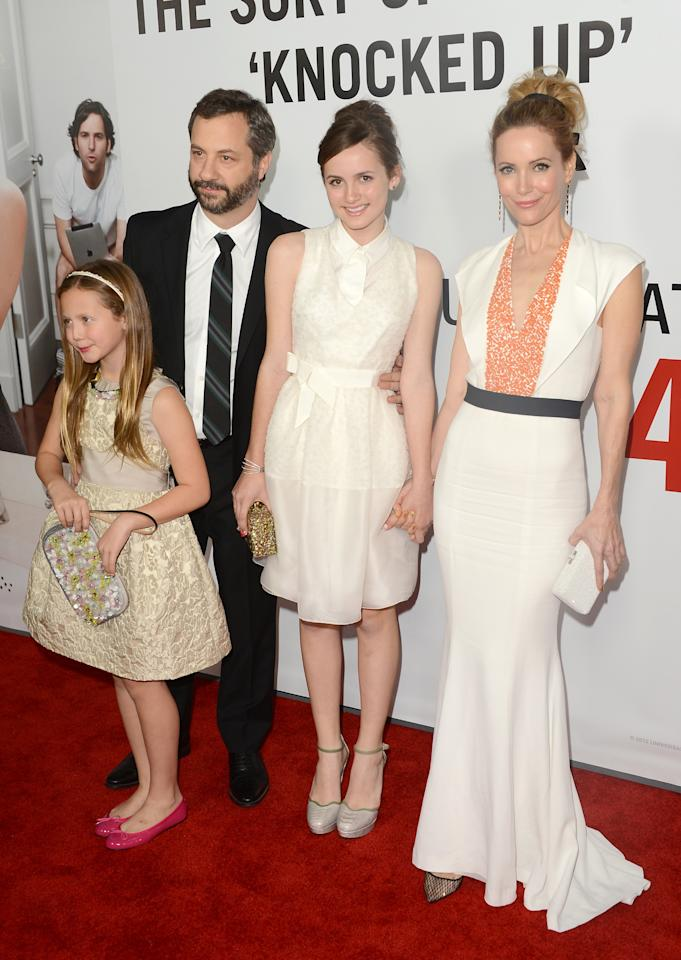 HOLLYWOOD, CA - DECEMBER 12:  Actors Leslie Mann and Judd Apatow arrive with daughters Maude Apatow and Iris Apatow at the premiere of Universal Pictures' 'This Is 40' at Grauman's Chinese Theatre on December 12, 2012 in Hollywood, California.  (Photo by Jason Merritt/Getty Images)