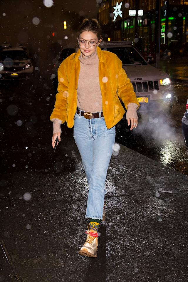 "<p>In a tan top, faux fur coat by <a rel=""nofollow"" href=""https://draclothing.com/products/selena-jacket?variant=1155404890136"">dRA Clothing</a>, and jeans while out in New York City.</p>"