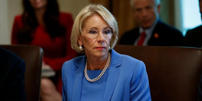 """FILE - In this July 16, 2019, file photo, Education Secretary Betsy DeVos listens during a Cabinet meeting in the Cabinet Room of the White House in Washington. The Trump administration is threatening to cut grant funding to a Middle East studies program at the University of North Carolina and Duke University, saying it's misusing federal funding to advance """"ideological priorities"""" and unfairly promotes """"the positive aspects of Islam"""" but not Christianity or Judaism. (AP Photo/Alex Brandon, File)"""