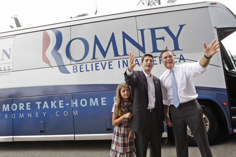 Republican presidential candidate, former Massachusetts Gov. Mitt Romney, right, and vice presidential candidate Wisconsin Rep. Paul Ryan are joined by Ryan's daughter Liza as they wave to the crowd while campaigning Saturday, Aug. 11, 2012 in Norfolk, Va. (AP Photo/Mary Altaffer)