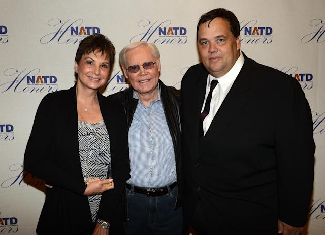 NASHVILLE, TN - NOVEMBER 14: Recording Artist Tanya Tucker and Mike Smardak - Outback Concerts (R) presents Singer/Songwriter George Jones (C) his NATD Award during the 2012 NATD Honors at The Hermitage Hotel on November 14, 2012 in Nashville, Tennessee. (Photo by Rick Diamond/Getty Images for Nashville Association of Talent Directors)