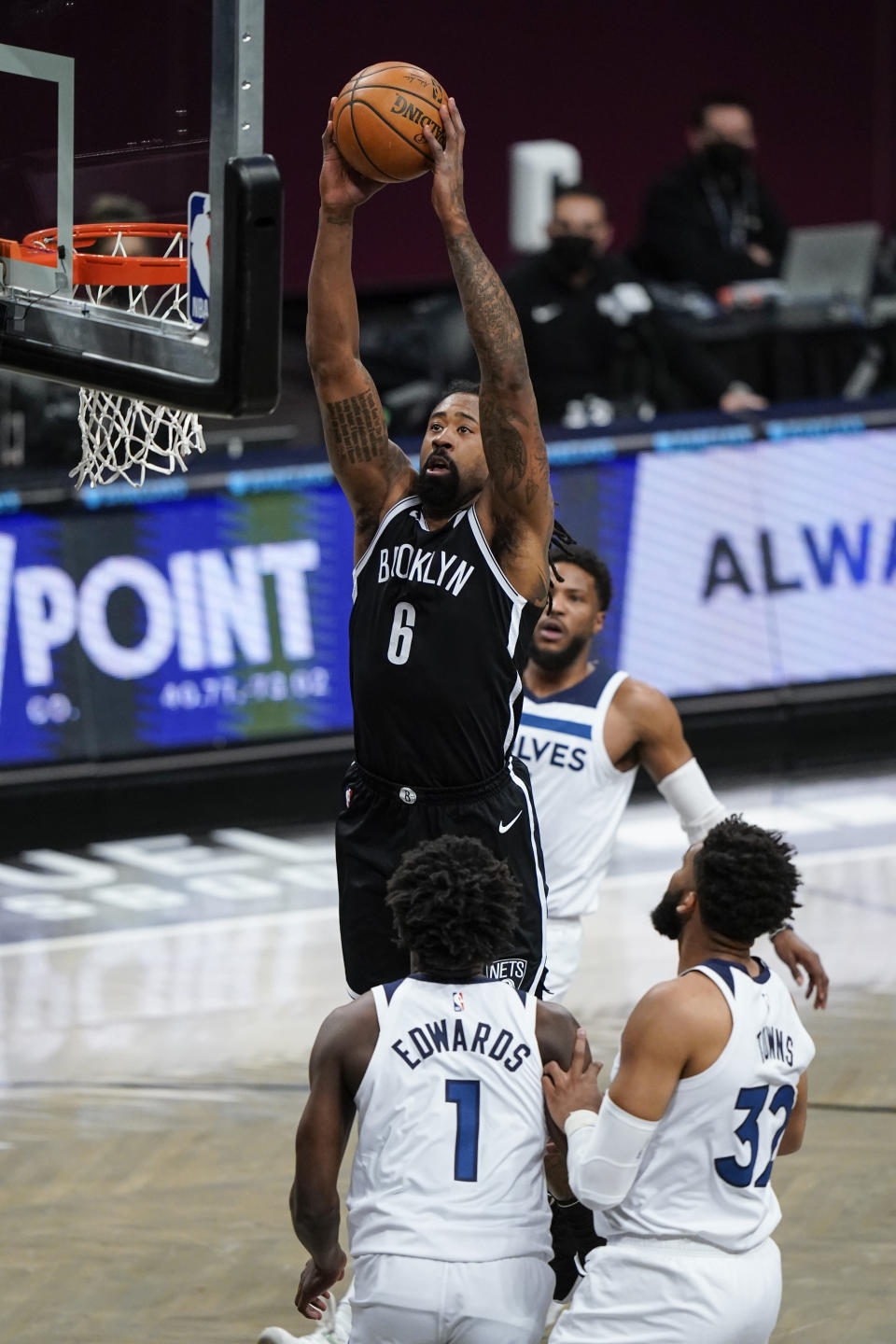 Brooklyn Nets' DeAndre Jordan (6) dunks in front of Minnesota Timberwolves' Karl-Anthony Towns (32) and Anthony Edwards (1) during the first half of an NBA basketball game Monday, March 29, 2021, in New York. (AP Photo/Frank Franklin II)