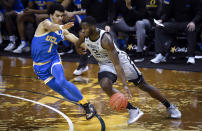 UCLA guard Jules Bernard (1) defends against Oregon forward Eugene Omoruyi (2) during the first half of an NCAA college basketball game Wednesday, March 3, 2021, in Eugene, Ore. (AP Photo/Andy Nelson)