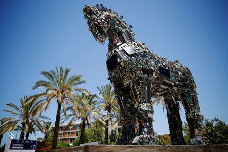 "FILE PHOTO: A ""Cyber Horse"", made from thousands of infected computer and cell phone bits, is displayed at the entrance to the annual Cyberweek conference at Tel Aviv University"