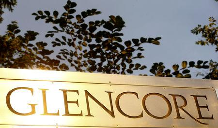 FILE PHOTO: The logo of commodities trader Glencore is pictured in front of the company's headquarters in Baar, Switzerland, July 18, 2017.  REUTERS/Arnd Wiegmann/File Photo