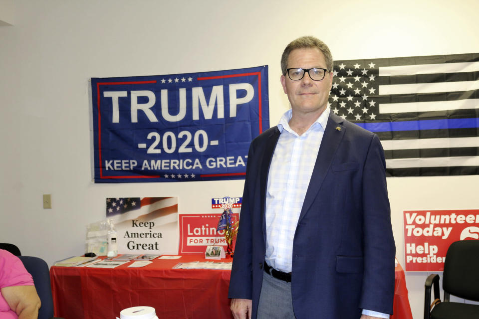 Dean Black, the chair of the Duval County Republican Party, poses for a photo at party headquarters in Jacksonville, Fla., on Thursday, Oct. 22, 2020. (AP Photo/Bobby Caina Calvan)