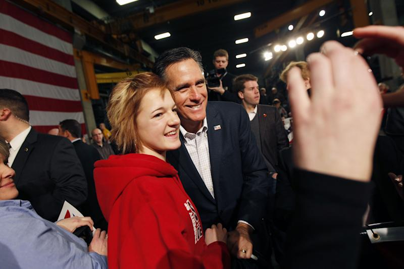 Republican presidential candidate, former Massachusetts Gov. Mitt Romney poses for photos after a campaign event in Fargo, N.D., Thursday, March 1, 2012. (AP Photo/Gerald Herbert)