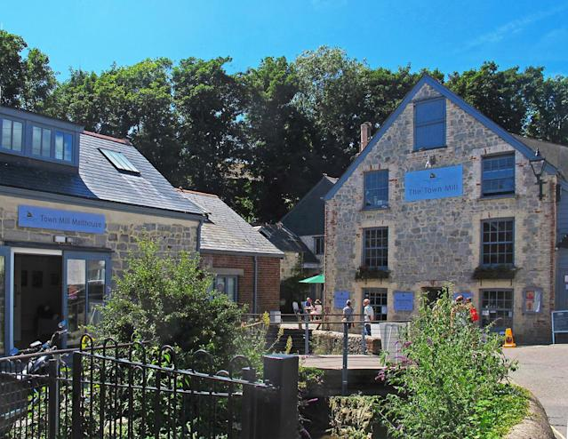 Learn about the rescue and restoration of the mill at The Town Mill. [Photo: Visit Dorset]