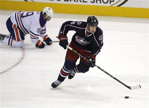 Columbus Blue Jackets' R.J. Umberger (18) races away from Edmonton Oilers' Sam Gagner (89) in the first period of their NHL hockey game, Tuesday, March, 5, 2013, in Columbus, Ohio. (AP Photo/Mike Munden)