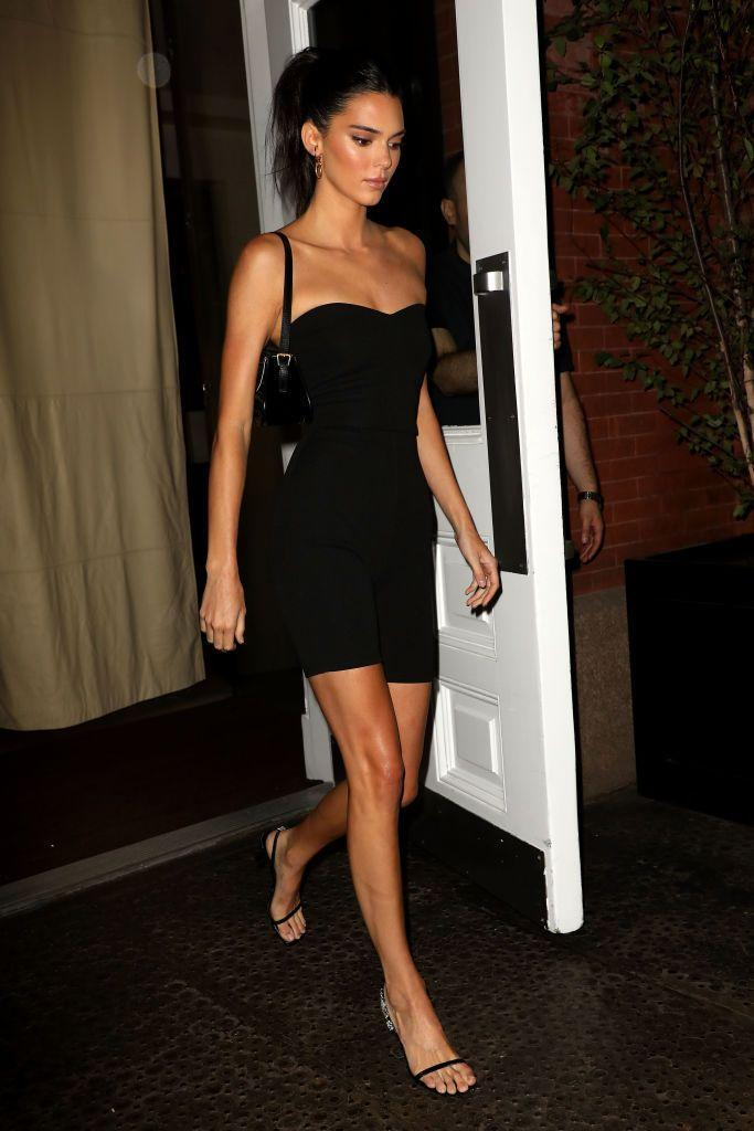 <p>The model wore a skintight black romper to have dinner in New York.</p>