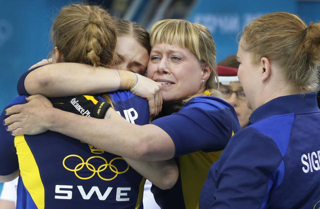 Sweden's women's curling team from left to right, Christina Bertrup, Maria Wennerstroem, Maria Prytz and Margaretha Sigfridsson celebrate after beating Switzerland during the women's curling semifinal game at the 2014 Winter Olympics, Wednesday, Feb. 19, 2014, in Sochi, Russia. (AP Photo/Wong Maye-E)