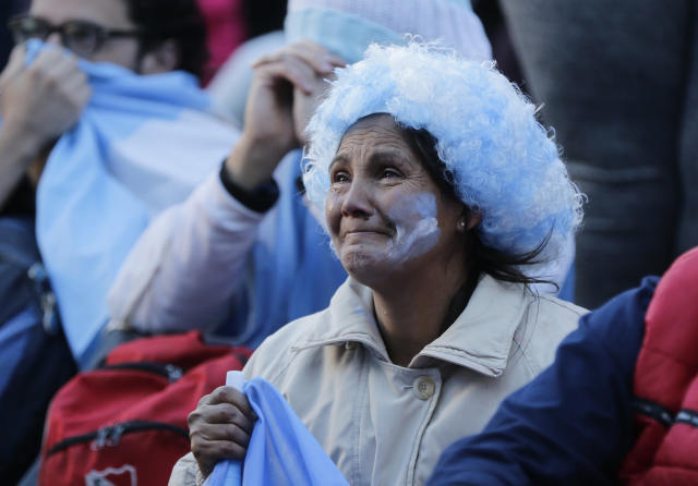 Argentine fans react in disbelief at the end of a televised broadcast of the Croatia vs Argentina World Cup soccer match, in Buenos Aires, Argentina, Thursday, June 21, 2018. Argentina lost 3-0 to Croatia. (AP Photo Jorge Saenz)