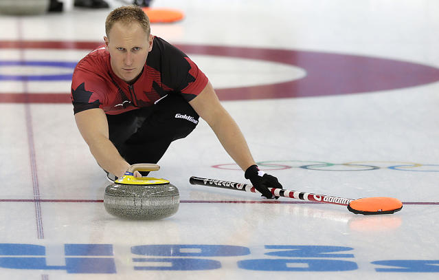 Canada's Brad Jacobs delivers the rock during the men's curling training session at the 2014 Winter Olympics, Sunday, Feb. 9, 2014, in Sochi, Russia. (AP Photo/Wong Maye-E)