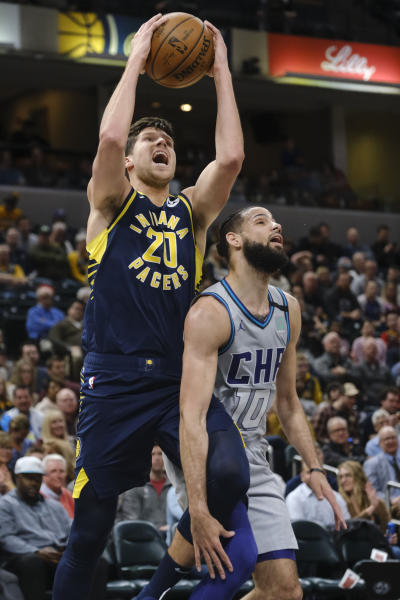Indiana Pacers forward Doug McDermott (20) shoots over Charlotte Hornets forward Caleb Martin (10) during the second half of an NBA basketball game in Indianapolis, Tuesday, Feb. 25, 2020. (AP Photo/AJ Mast)