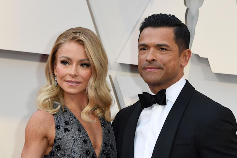 Kelly Ripa and Mark Consuelos pose on the red carpet