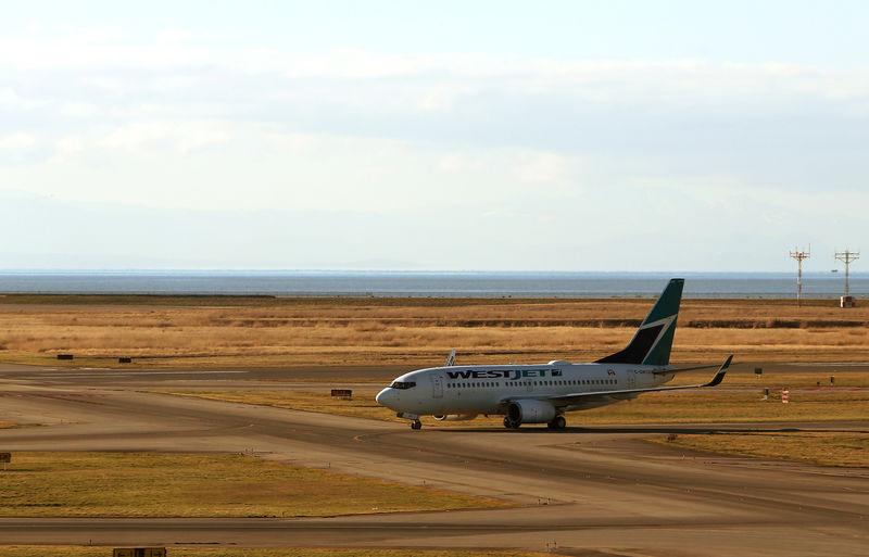 A WestJet Boeing 737 airplane is pictured at Vancouver's international airport in Richmond,