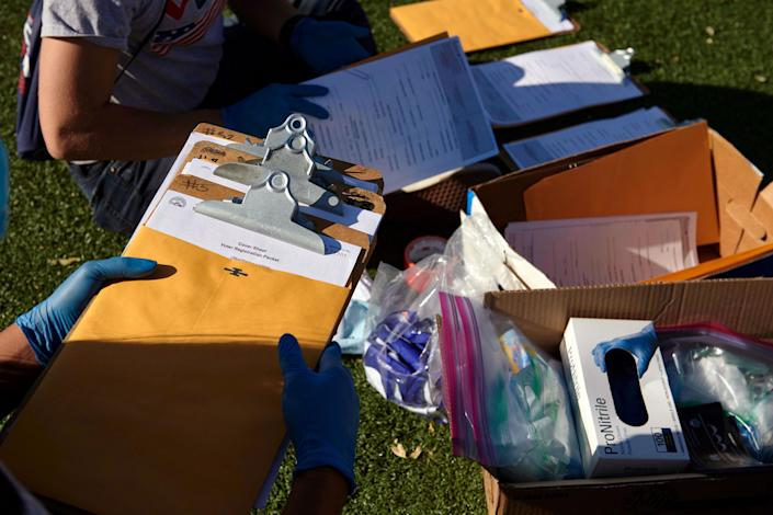 Mi Familia Vota workers organized their voter registration materials and personal protective equipment before canvassing in Las Vegas on Saturday, Sept. 12, 2020. (Bridget Bennett/The New York Times)