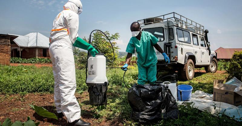 World Health Organization workers decontaminate the house of a pastor who has just tested positive for Ebola in Beni, June 13, 2019.