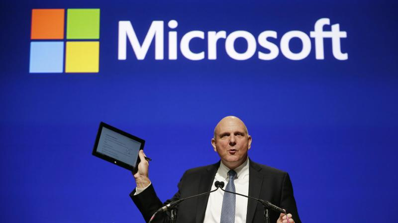 Microsoft CEO Steve Ballmer holds up his personal tablet device as he speaks at the company's annual shareholders meeting Tuesday, Nov. 19, 2013, in Bellevue, Wash. The company, based in Redmond, Washington, says that all of its proposals, including the re-election of board nominees including Ballmer and chairman Bill Gates, were approved. (AP Photo/Elaine Thompson)