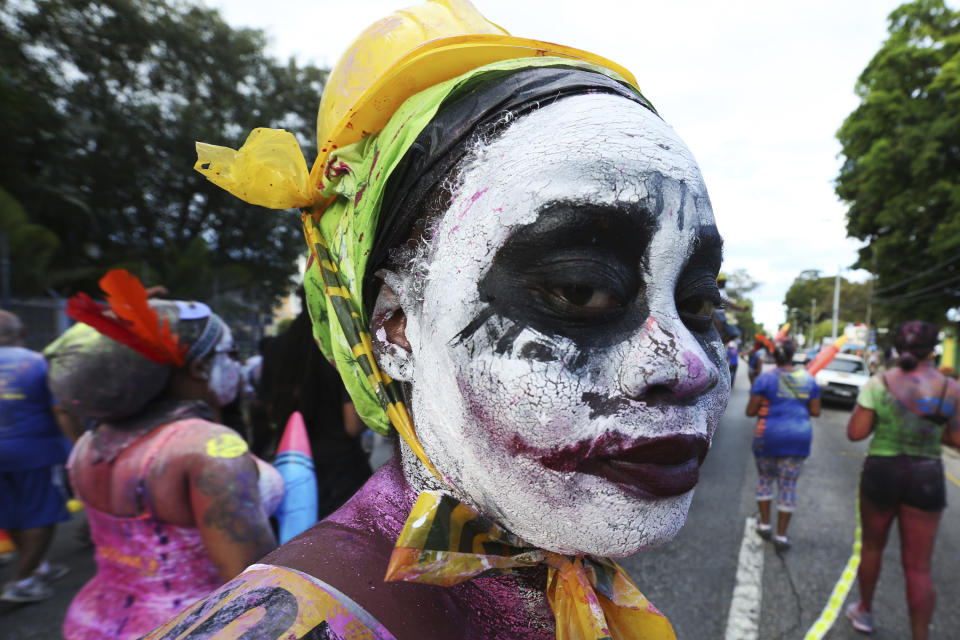 PORT OF SPAIN, TRINIDAD - FEBRUARY 27: J'ouvert reveller looks on during a parade with the Rapso music band 3canal for the 20th anniversary celebration of their song Blue as part of Trinidad Carnival at Queen's Park Savannah on February 27, 2017 in Port of Spain, Trinidad. (Photo by Sean Drakes/LatinContent via Getty Images)