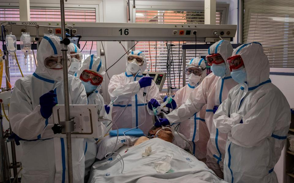 A patient infected with Covid-19 is treated in one of the intensive care units at the Severo Ochoa hospital in Leganes, outskirts of Madrid, Spain - AP