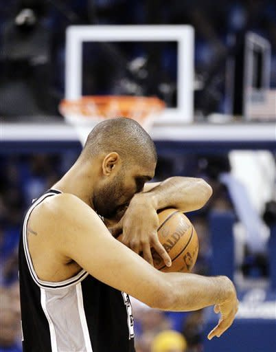 San Antonio Spurs center Tim Duncan walks on the court before playing against the Oklahoma City Thunder in Game 3 of their NBA basketball Western Conference finals playoff series, Thursday, May 31, 2012, in Oklahoma City. (AP Photo/Eric Gay)