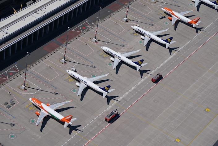 SCHOENEFELD, GERMANY - JUNE 01: Passenger planes of discount airlines EasyJet and Ryanair that have been temporarily pulled out of service stand parked at Berlin-Brandenburg Airport during the coronavirus crisis on June 01, 2020 in Schoenefeld, Germany. Countries across Europe are easing lockdown measures and many are seeking to promote a return of international travel and tourism. At the same time airlines are still facing a calamitous era, with some already receiving government bailouts and many announcing layoffs.  (Photo by Sean Gallup/Getty Images)