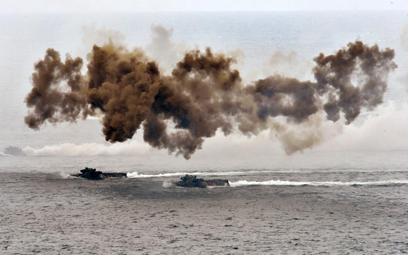 Taiwan conducts military drills simulating China invasion