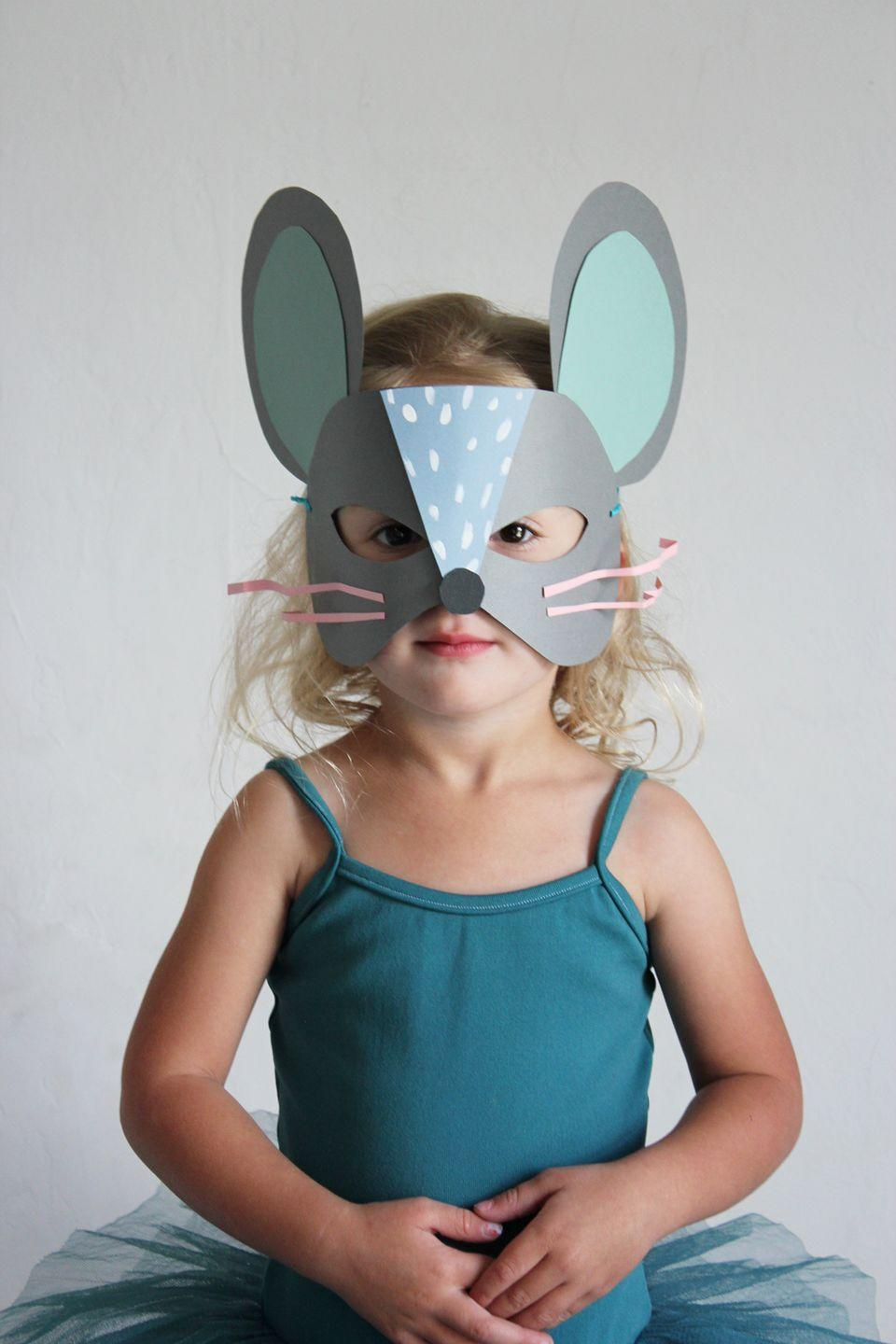 """<p>Transform your toddler into a scurrying cutie with this printable template-turned mask. </p><p><strong>Get the tutorial at <a href=""""http://mermagblog.com/paper-cat-and-mouse-mask-diys/"""" rel=""""nofollow noopener"""" target=""""_blank"""" data-ylk=""""slk:Mer Mag"""" class=""""link rapid-noclick-resp"""">Mer Mag</a>.</strong></p>"""