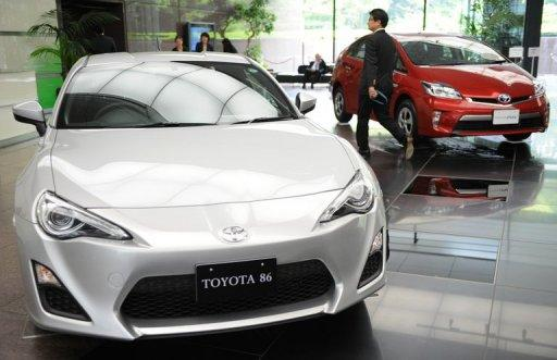 Toyota Motor's vehicles are seen at its head office showroom in Tokyo, in May. Toyota Motor has returned to the top of the global carmakers' league, Japanese media reported on Thursday, after the firm said it had sold almost five million vehicles in the first half of the year