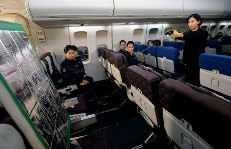 Cabin crews attend a training session on how to manage in-flight disturbances in Seoul, South Korea, December 27, 2016.   Oh Dae-il/News1 via REUTERS