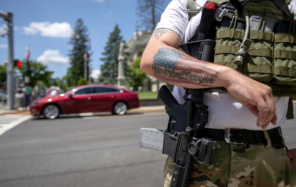 Second Amendment advocate Justin Hall of Roanoke stands guard with his firearm near the Marion, Va. courthouse and Confederate statue on July 3, 2020. (Andre Teague / Bristol Herald Courier via AP file)